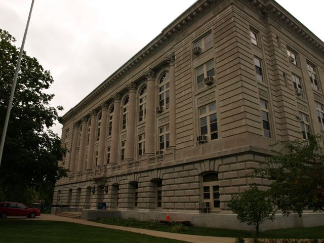 View from northeast corner. Shows columns along second and third floors, with ornate carvings at the top.
