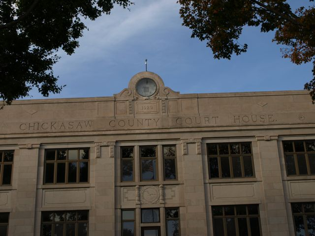 "A closer view of art deco design; carved text ""Chickasaw County Court House"""