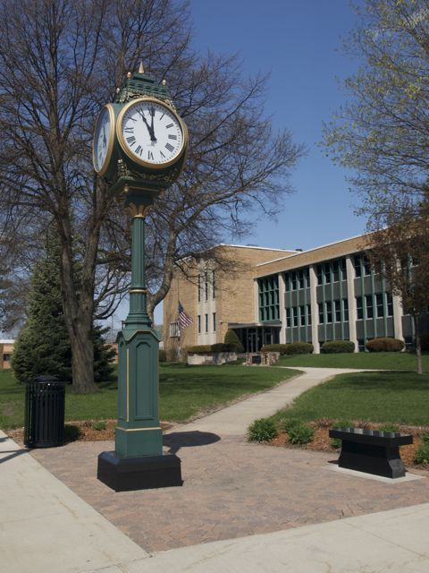 Tower clock on the corner, with Kossuth County Courthouse in the background