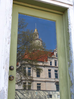 A reflected view of the courthouse from a store on the west side of the square