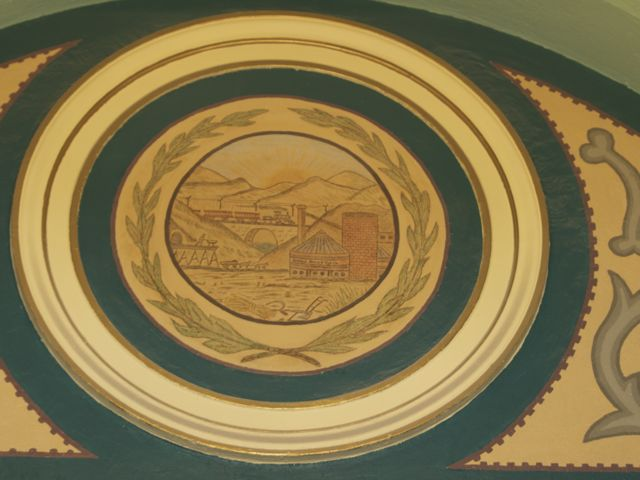 Dallas County Seal in the rotunda arch, paint color and details the result of historic restoration