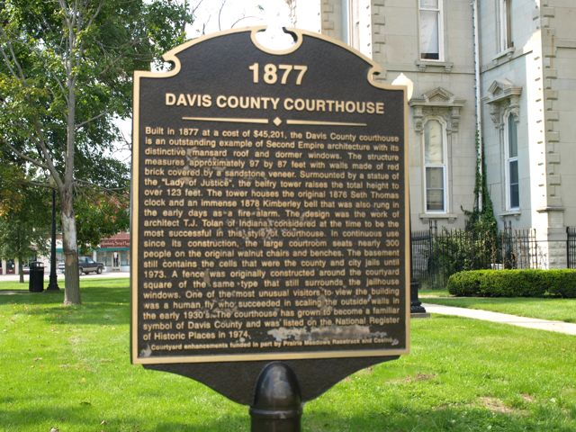 "historical plaque on the courthouse lawn: ""1877 Davis County Courthouse"" followed by a large paragraph of information"