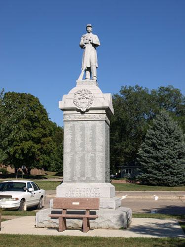 Civil war memorial - tall base with soldier at parade rest on top.