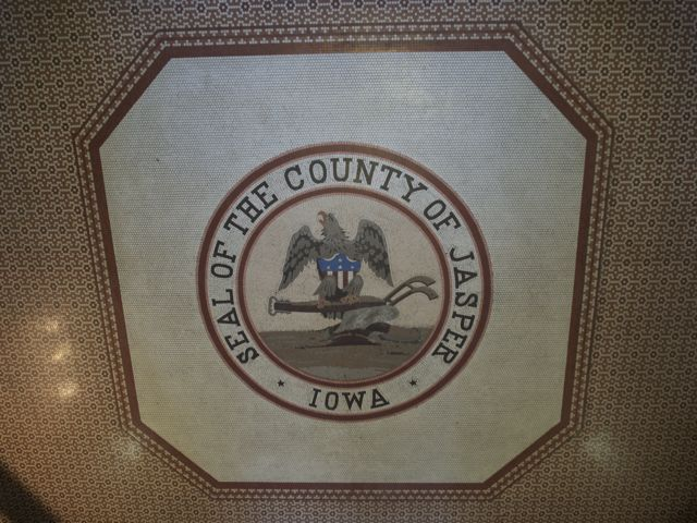 The Jasper County Seal in mosaic tile on the floor of the rotunda