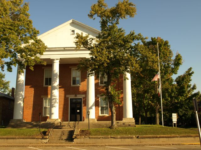 South view of the courthouse. The four columns are in front of the two story brick structure