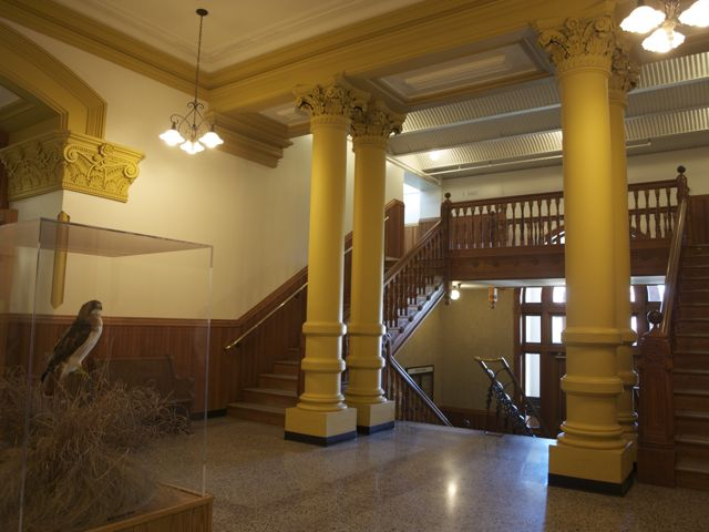 A view of the lobby, facing northwest. The columns and staircase are shown