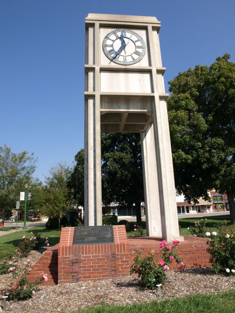 A separate clock tower structure on the west side of the courthouse