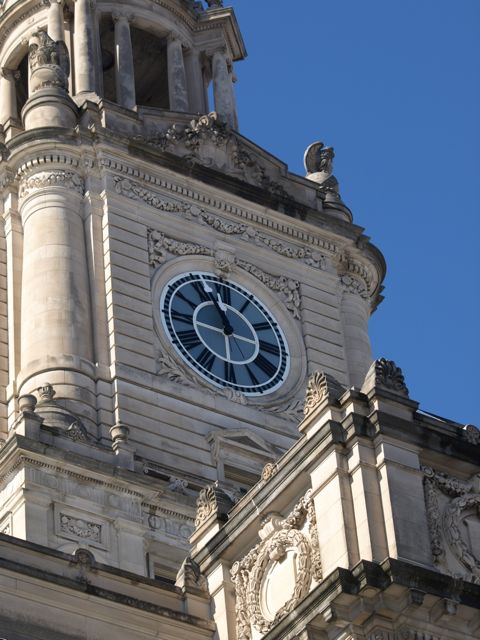 Details of stone carving on the clock tower and roof line