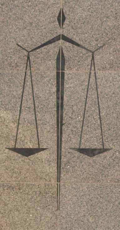 Modern symbol of scales of justice in polished stone