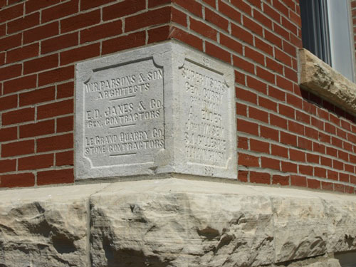 Cornerstone on the southwest corner. Text includes architect, contractors, and stone contractors
